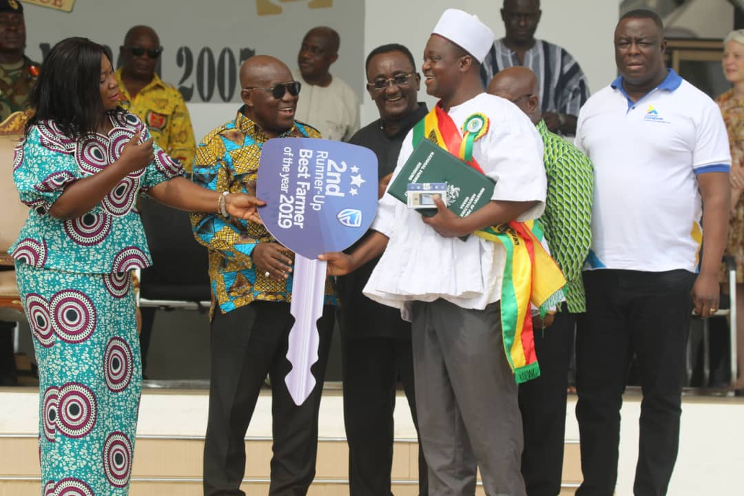 Alhaji Abdulai Seidu Antiku, Managing Director of Antika Company Limited, collecting his award from the President of the Republic of Ghana.